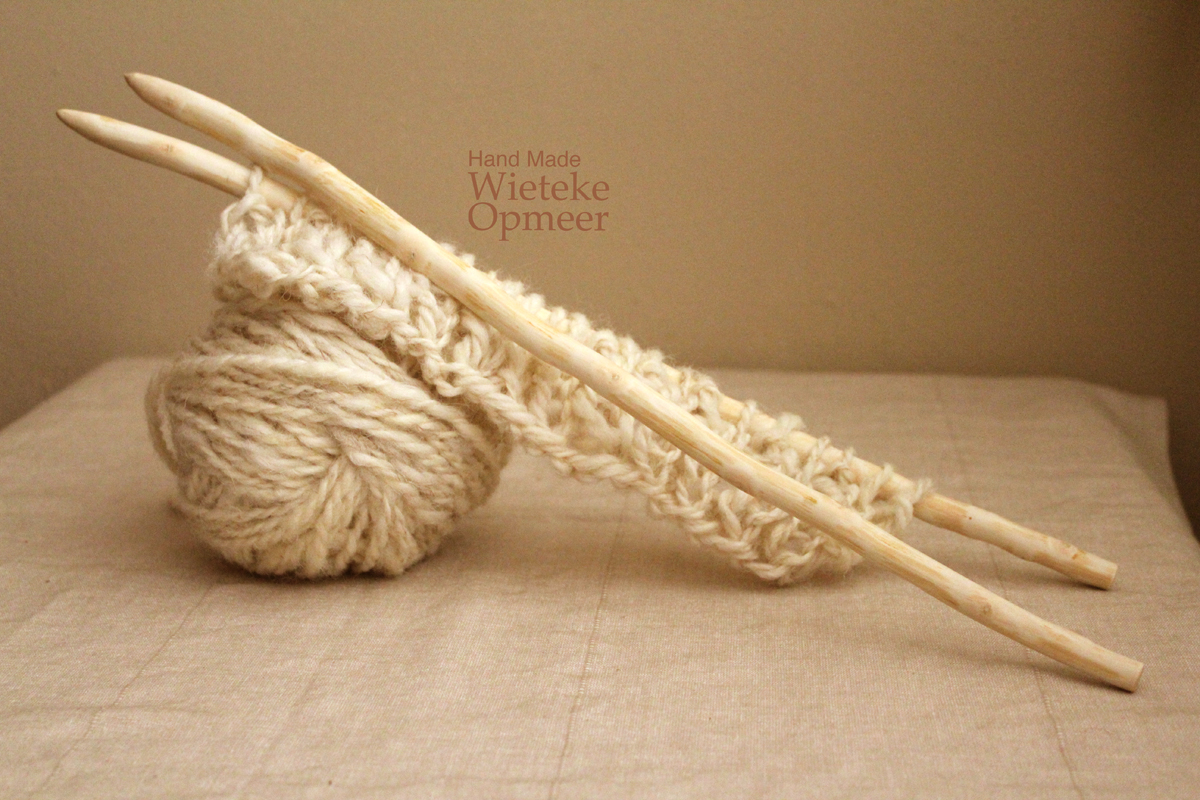 knitting needles with knitted wool