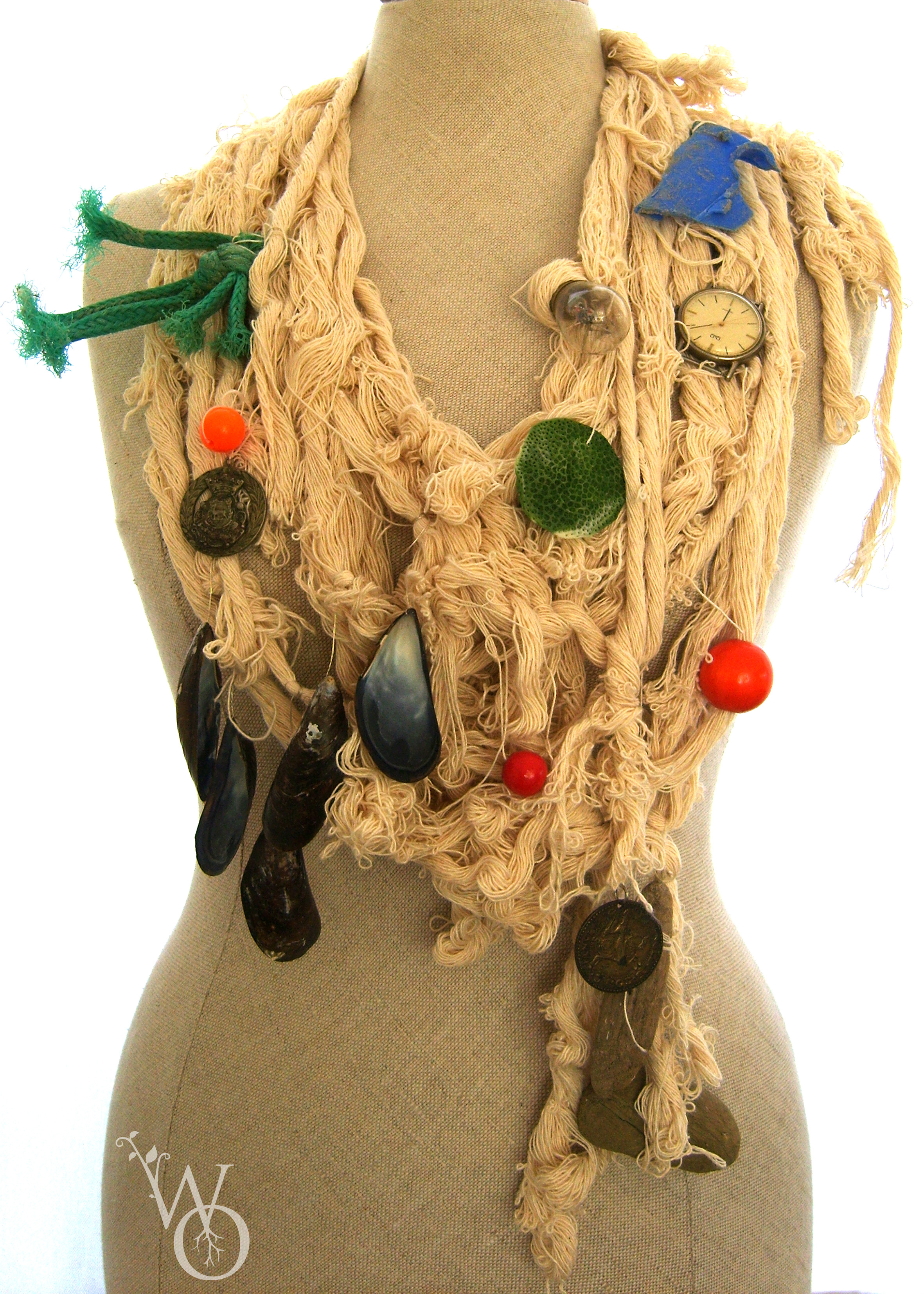 Necklace made from rope and various items natural and man made from the sea, watch parts.