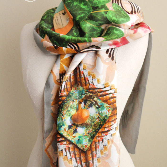 scarf with a colourful photorealistic print of various objects.