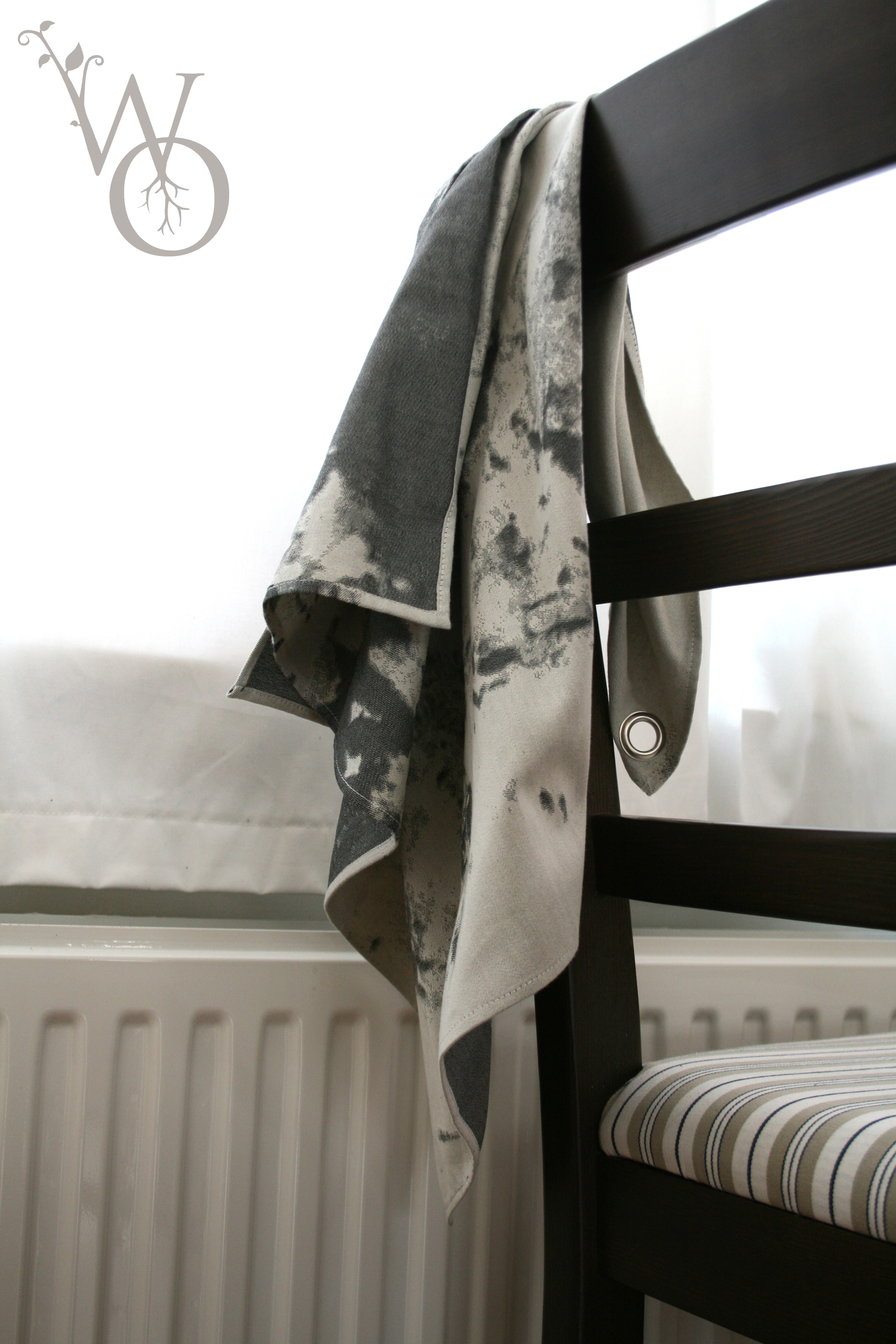 Quality woven black and white pattern Tea Towel 'Ranzig' draped over chair