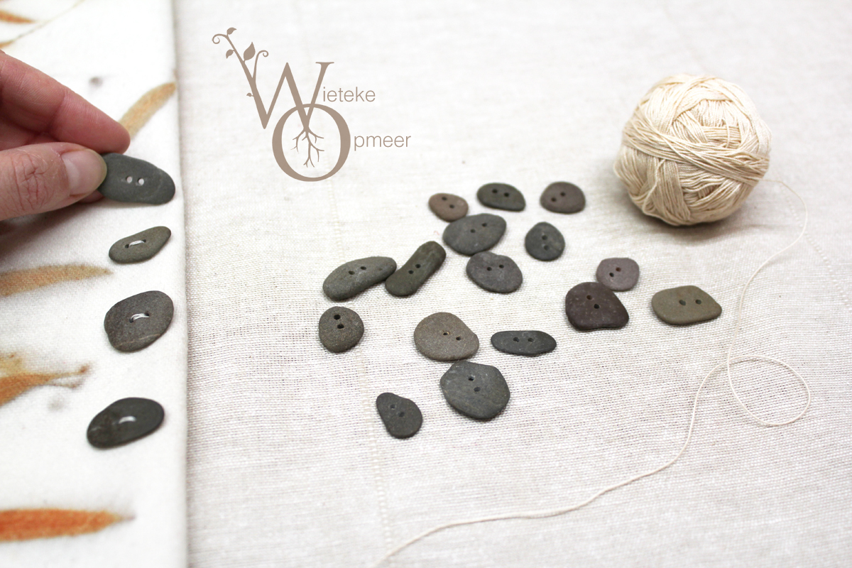 handmade riverstone buttons on fabric